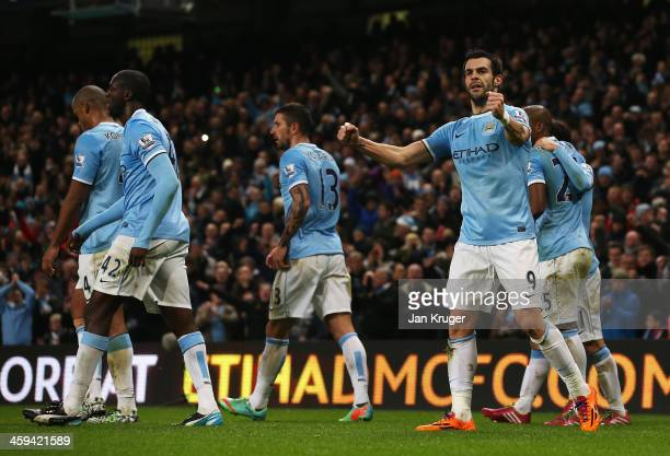 Alvaro Negredo of Manchester City celebrates his goal during the Barclays Premier League match between Manchester City and Liverpool at Etihad...