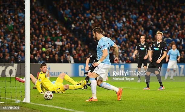 Alvaro Negredo of Manchester City scores his team's third goal during the UEFA Champions League Group D match between Manchester City and FC Viktoria...