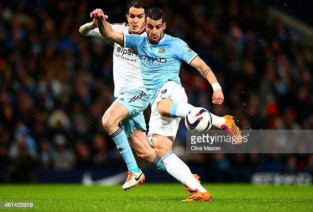 Alvaro Negredo of Manchester City scores the opening goal during the Capital One Cup SemiFinal first leg match between Manchester City and West Ham...