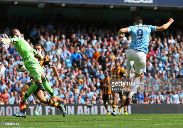 Alvaro Negredo of Manchester City scores the opening goal past Allan McGregor of Hull City during the Barclays Premier League match between...