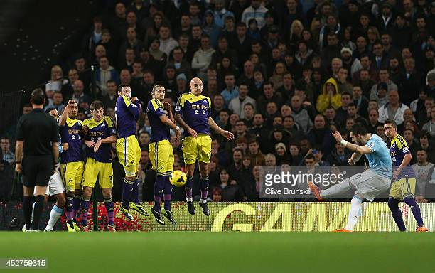 Alvaro Negredo of Manchester City scores the opening goal with a free kick during the Barclays Premier League match between Manchester City and...