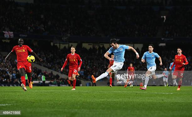 Alvaro Negredo of Manchester City shoots to score his team's second goal during the Barclays Premier League match between Manchester City and...