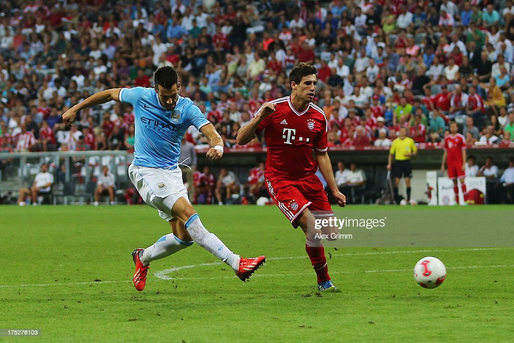 Alvaro Negredo of Manchester scores his team's first goal against Javier Martinez of Muenchen during the Audi Cup Final match between FC Bayern Muenchen and Manchester City at Allianz Arena on August 1, 2013 in Munich, Germany.