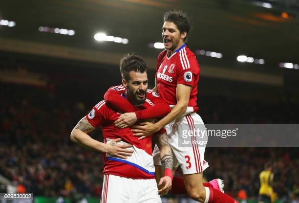 Alvaro Negredo of Middlesbrough celebrates as he scores their first goal with George Friend of Middlesbrough during the Premier League match between...