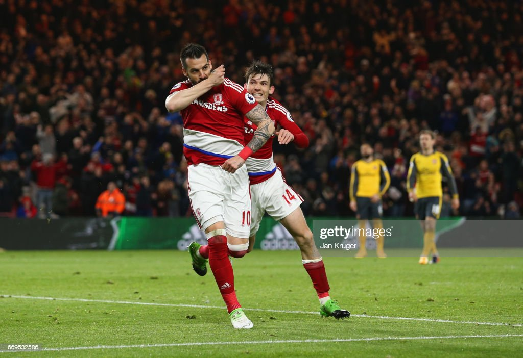 Alvaro Negredo of Middlesbrough (10) celebrates as he scores their first goal with Marten de Roon during the Premier League match between Middlesbrough and Arsenal at Riverside Stadium on April 17, 2017 in Middlesbrough, England.
