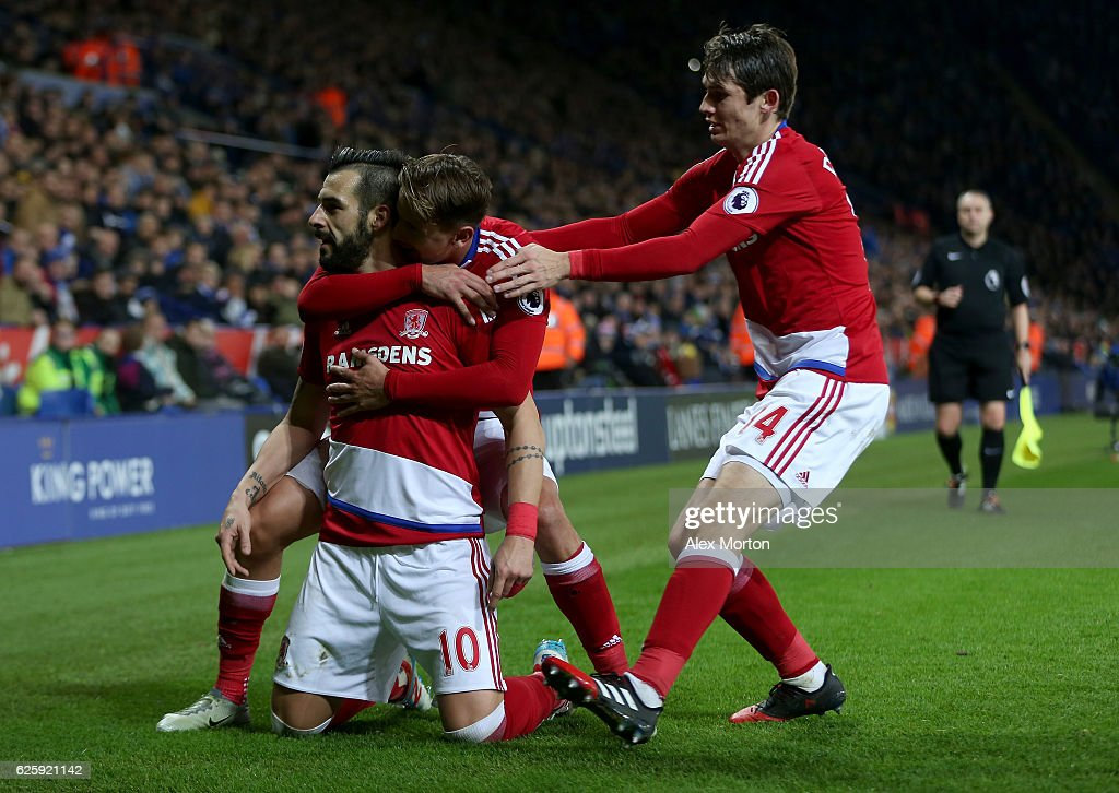 Alvaro Negredo (L) of Middlesbrough celebrates scoring his team's second goal with his team mates Gaston Ramirez (C) and Marten de Roon (R) during the Premier League match between Leicester City and Middlesbrough at The King Power Stadium on November 26, 2016 in Leicester, England.