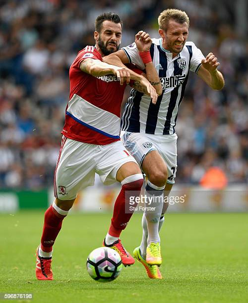 Alvaro Negredo of Middlesbrough challenges for the ball with Gareth McAuley of West Bromwich Albion during the Premier League match between West...