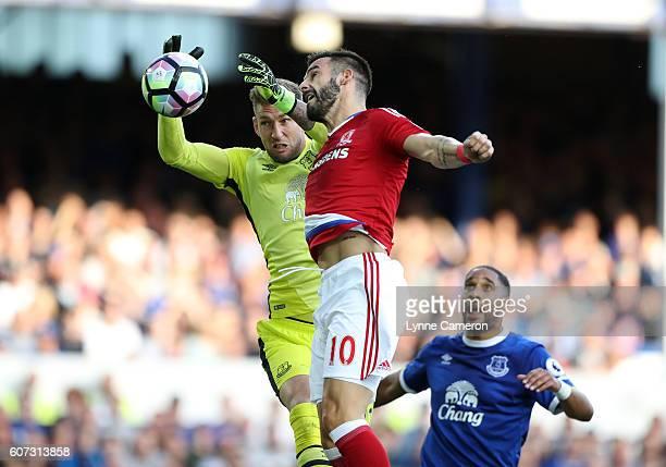 Alvaro Negredo of Middlesbrough challenges Maarten Steklenburg of Everton to score during the Premier League match between Everton and Middlesbrough...