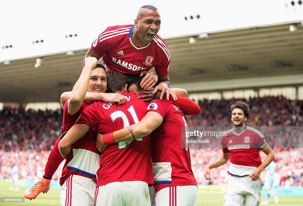 Alvaro Negredo of Middlesbrough is mobbed by team mates after scoring his sides first goal during the Premier League match between Middlesbrough and Stoke City at Riverside Stadium on August 13, 2016 in Middlesbrough, England.