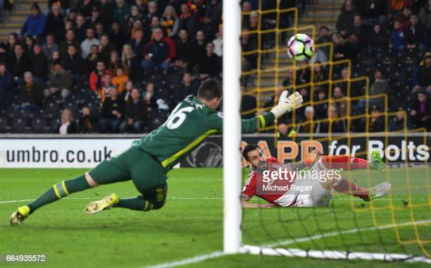 Alvaro Negredo of Middlesbrough scores his sides first goal past Eldin Jakupovic of Hull City during the Premier League match between Hull City and...