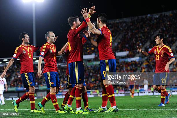 Alvaro Negredo of Spain celebrates with his teammates after scoring his team's second goal during the FIFA 2014 World Cup Qualifier match between...