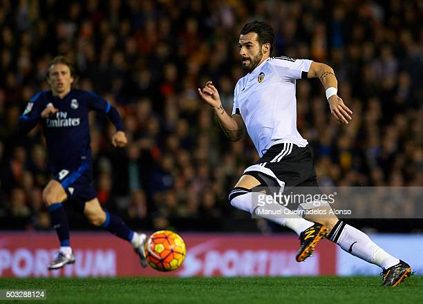 Alvaro Negredo of Valencia runs with the ball during the La Liga match between Valencia CF and Real Madrid CF at Estadi de Mestalla on January 03...