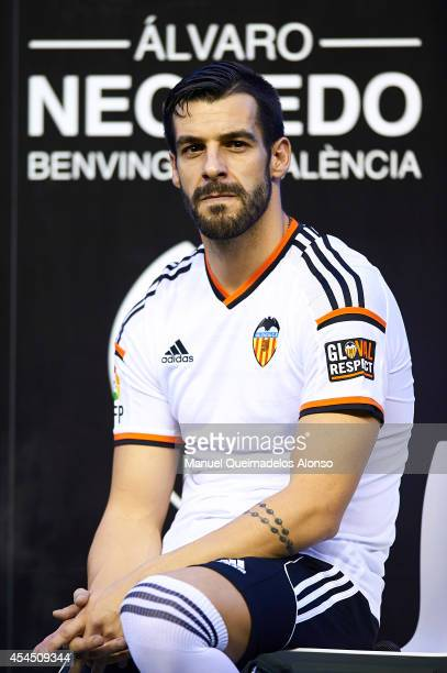 Alvaro Negredo poses during his presentation as a new player for Valencia CF at at Estadi de Mestalla on September 2 2014 in Valencia Spain