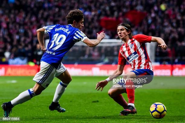 Alvaro Odriozola Arzallus of Real Sociedad fights for the ball with Filipe Luis of Atletico de Madrid during the La Liga 201718 match between...
