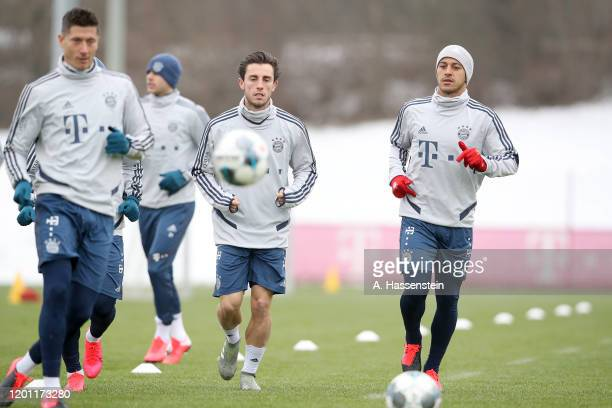 Alvaro Odriozola of FC Bayern Muenchen and his team mate Thiago Alcantara during a training session at Saebener Strasse training ground on January 22...