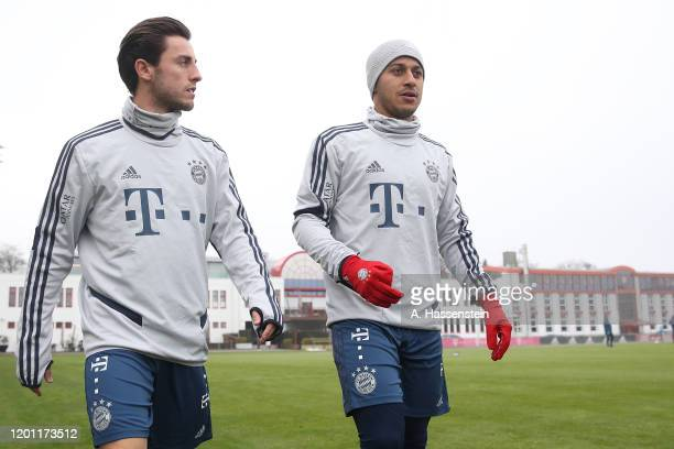 Alvaro Odriozola of FC Bayern Muenchen arrives with his team mate Thiago Alcantara for a training session at Saebener Strasse training ground on...