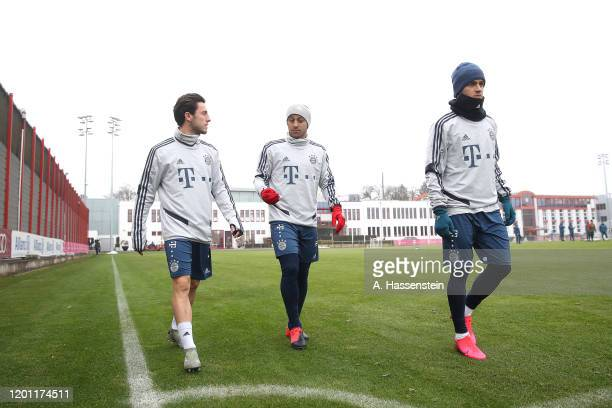 Alvaro Odriozola of FC Bayern Muenchen arrives with his team mates Thiago Alcantara and Philippe Coutinho for a training session at Saebener Strasse...