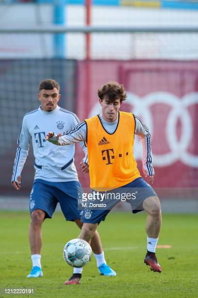 Alvaro Odriozola of FC Bayern Muenchen controls the ball next to his team mate Oliver BatistaMeier during a training session at Saebener Strasse...