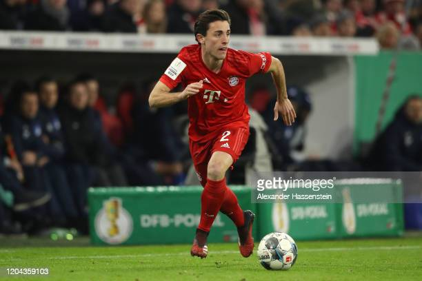 Alvaro Odriozola of FC Bayern Muenchen runs with the ball during the DFB Cup round of sixteen match between FC Bayern Muenchen and TSG 1899...