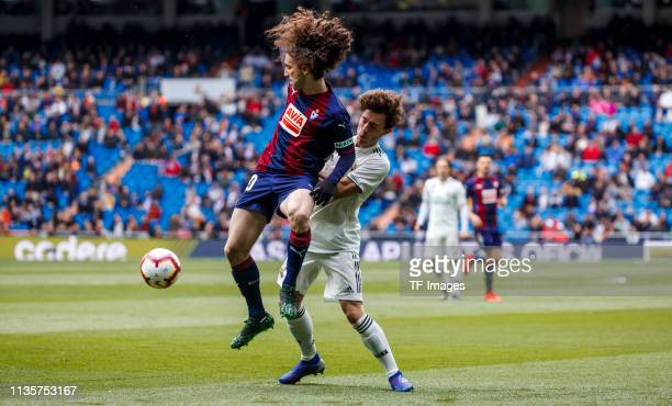Alvaro Odriozola of Real Madrid and Cuncurella of SD Eibar battle for the ball during the La Liga match between Real Madrid CF and SD Eibar at...