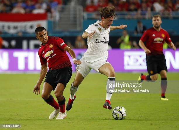 Alvaro Odriozola of Real Madrid competes for the ball with Alexis Sanchez of Manchester United during the International Champions Cup 2018 match...