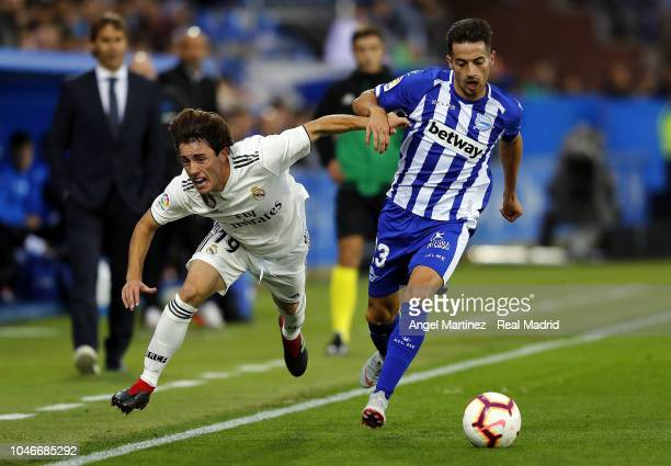 Alvaro Odriozola of Real Madrid competes for the ball with Jony Rodriguez of Deportivo Alaves during the La Liga match between Deportivo Alaves and...
