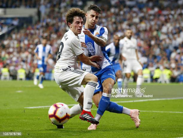 Alvaro Odriozola of Real Madrid competes for the ball with Mario Hermoso of RCD Espanyol during the La Liga match between Real Madrid and RCD...