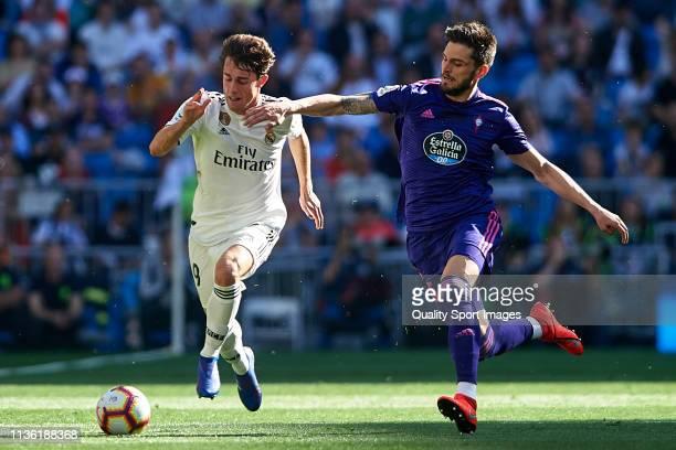 Alvaro Odriozola of Real Madrid competes for the ball with Okay Yokuslu of RC Celta de Vigo during the La Liga match between Real Madrid CF and RC...