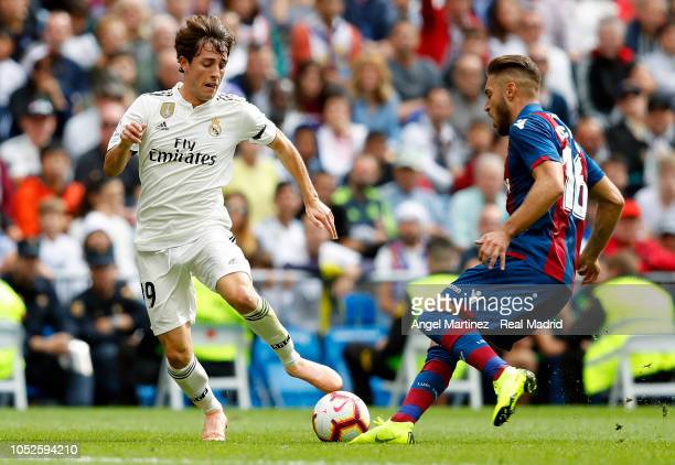 Alvaro Odriozola of Real Madrid competes for the ball with Ruben Rochina of Levante UD during the La Liga match between Real Madrid CF and Levante UD...