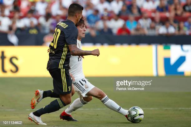 Alvaro Odriozola of Real Madrid controls the ball against Joao Cancelo of Juventus during the International Champions Cup 2018 at FedExField on...