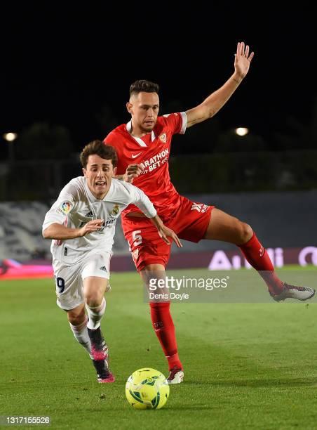 Alvaro Odriozola of Real Madrid is challenged by Lucas Ocampos of Sevilla during the La Liga Santander match between Real Madrid and Sevilla FC at...