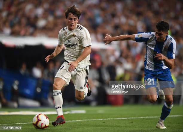 Alvaro Odriozola of Real Madrid outpaces Marc Roca of RCD Espanyol during the La Liga match between Real Madrid CF and RCD Espanyol at Estadio...