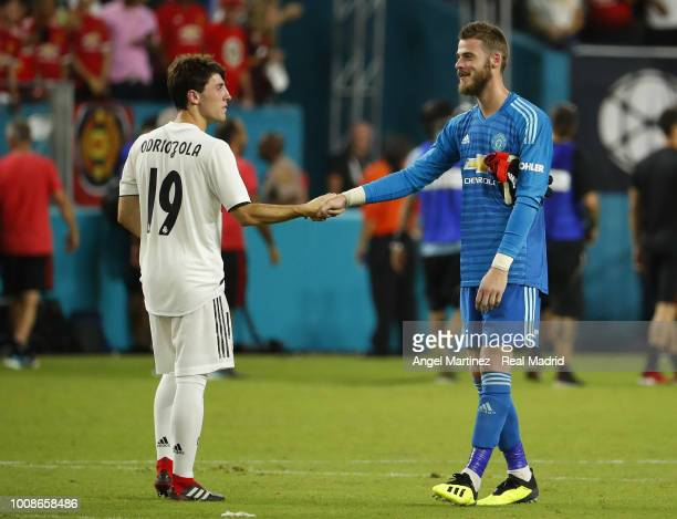Alvaro Odriozola of Real Madrid shakes hands with David de Gea of Manchester United after the International Champions Cup 2018 match between...