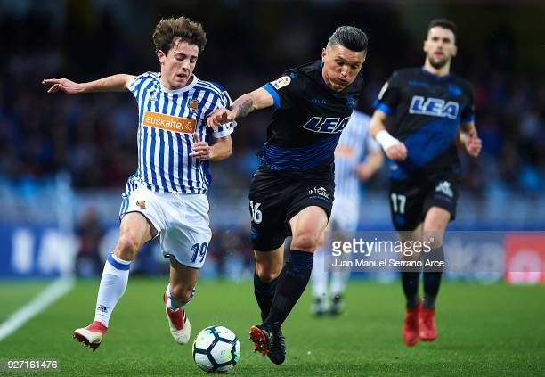 Alvaro Odriozola of Real Sociedad competes for the ball with Daniel Torres of Deportivo Alaves during the La Liga match between Real Sociedad and...