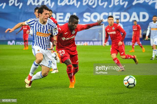 Alvaro Odriozola of Real Sociedad duels for the ball with Amath of Getafe during the Spanish league football match between Real Sociedad and Getafe...