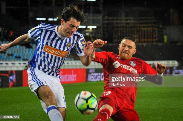 Alvaro Odriozola of Real Sociedad duels for the ball with Anatunes of Getafe during the Spanish league football match between Real Sociedad and...