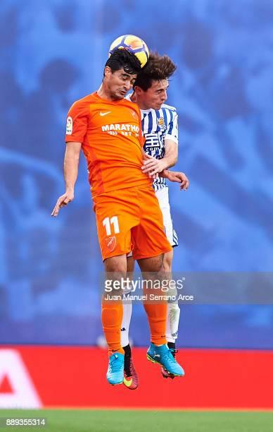 Alvaro Odriozola of Real Sociedad duels for the ball with Chory Castro of Malaga CF during the La Liga match between Real Sociedad de Futbol and Real...