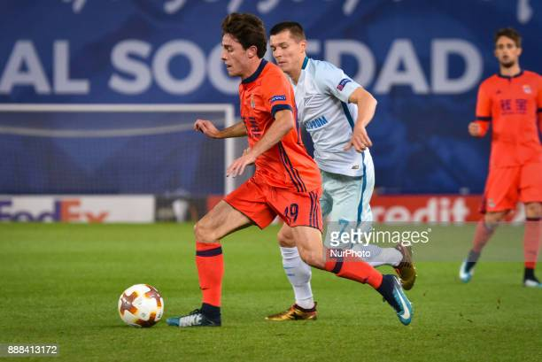 Alvaro Odriozola of Real Sociedad duels for the ball with Dmitri Poloz of Zenit during the UEFA Europa League Group L football match between Real...