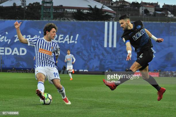 Alvaro Odriozola of Real Sociedad duels for the ball with Guidetti of Alaves during the Spanish league football match between Real Sociedad and...