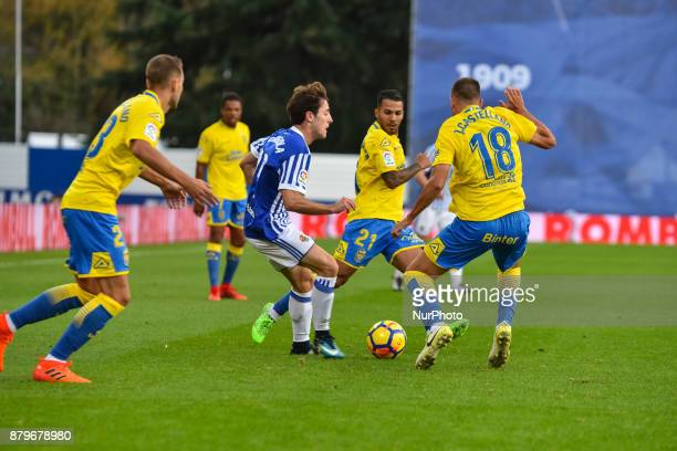 Alvaro Odriozola of Real Sociedad duels for the ball with Jonathan Viera and J Castellano of U D Las Palmas during the Spanish league football match...