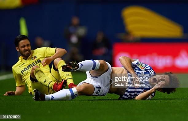 Alvaro Odriozola of Real Sociedad is tackled by Jaume Costa of Villarreal during the La Liga match between Villarreal and Real Sociedad at Estadio de...