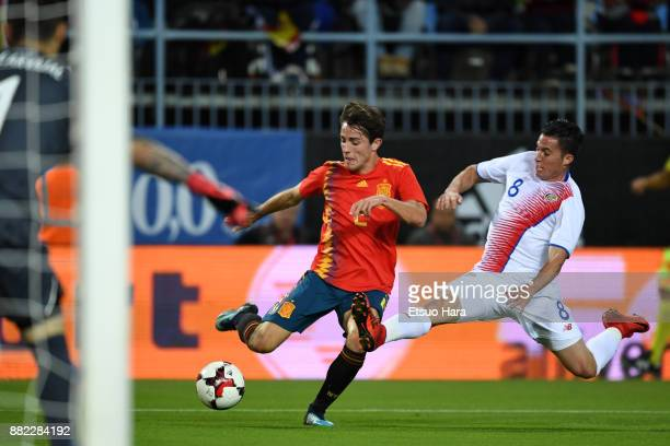 Alvaro Odriozola of Spain and Bryan Oviedo of Costa Rica compete for the ball during the international friendly match between Spain and Costa Rica at...