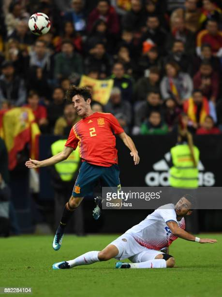 Alvaro Odriozola of Spain and Ronaldo Matarrita of Costa Rica compete for the ball during the international friendly match between Spain and Costa...
