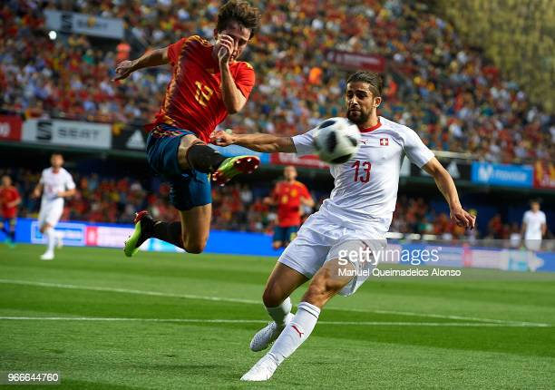 Alvaro Odriozola of Spain competes for the ball with Ricardo Rodriguez of Switzerland during the International Friendly match between Spain and...