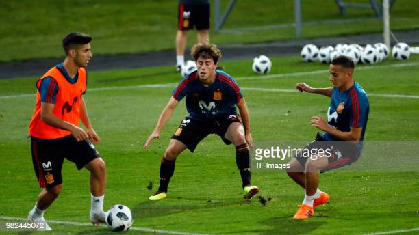 Alvaro Odriozola of Spain Marco Asensio of Spain and Lucas Vazquez of Spain battle for the ball during a training session on June 8 2018 in Krasnodar...