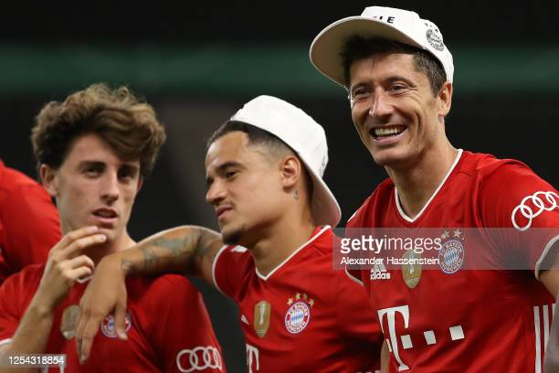 Alvaro Odriozola Philippe Coutinho and Robert Lewandowski of FC Bayern Muenchen celebrate after the DFB Cup final match between Bayer 04 Leverkusen...