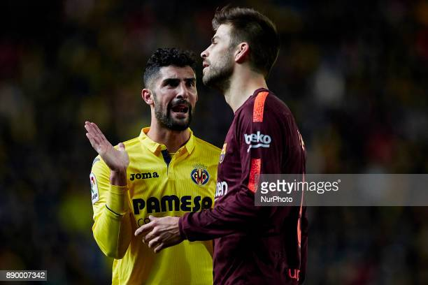 Alvaro of Villarreal CF reacts next to Gerard Pique of FC Barcelona during the La Liga game between Villarreal CF and FC Barcelona at Estadio de la...