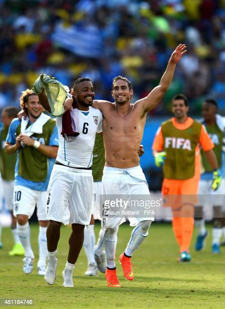 Alvaro Pereira and Martin Caceres of Uruguay celebrate the 10 win after the 2014 FIFA World Cup Brazil Group D match between Italy and Uruguay at...