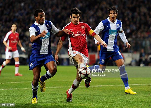 Alvaro Pereira of FC Porto and Cesc Fabregas of Arsenal battle for the ball during the UEFA Champions League last 16 first leg match between FC Porto...