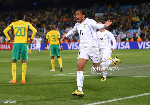 Alvaro Pereira of Uruguay celebrates scoring the third goal during the 2010 FIFA World Cup South Africa Group A match between South Africa and...